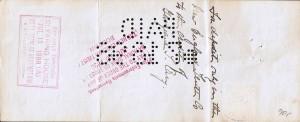 """Bagsiden af checken hvoraf det fremgår af perforeringen """"PAID"""" og datoen, at den er betalt den 18. juli år 1898, tre dage efter den er udstedt. Stemplet med Hamilton Manufacturing CO, Office. Det sidste ord er for utydeligt, kan ikke læses."""